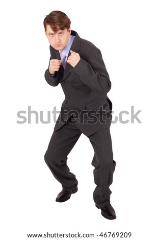 Young man in boxing fighting stance against a white background