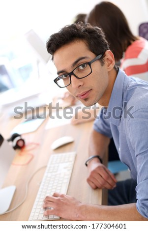 Young man in business apprenticeship - stock photo