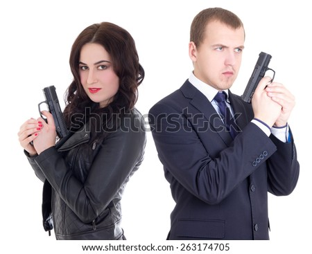 young man in business suit and elegant woman with guns isolated on white background - stock photo