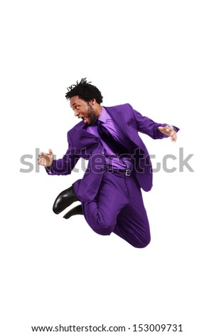 Young man in business suit jumps up high - stock photo