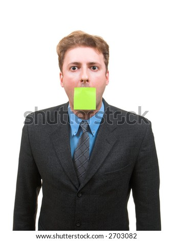 Young man in business suit with a sticky note attached to his mouth isolated on white - stock photo