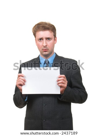 Young man in business suit with upset face showing a piece of paper in front of him isolated on white - stock photo