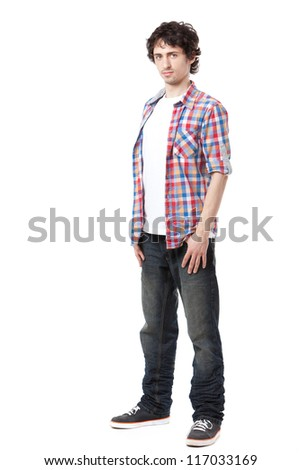 Young man in casual clothes posing over white background. - stock photo