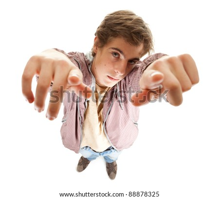 young man in casual jacket looking and pointing up, full length - stock photo