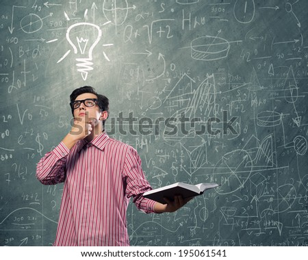 Young man in casual with book in hands - stock photo