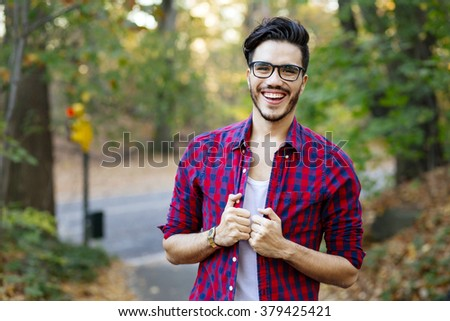 Young man in Central Park in autumn. New York. - stock photo