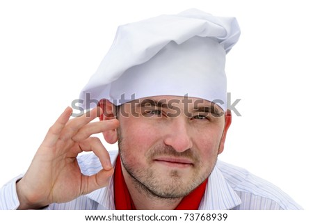 Young man in chef hat - stock photo