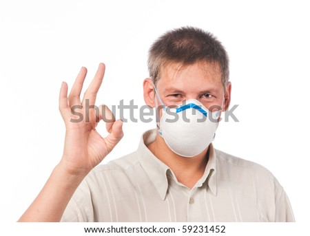 Young man in dust respirator - stock photo