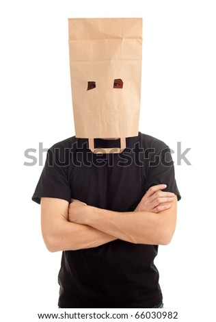 young man in ecological paper bag on head and crossed arms - stock photo