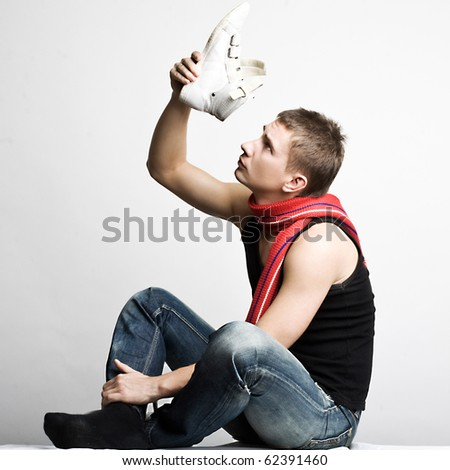 Young man in fashionable clothes studio photo shooting - stock photo