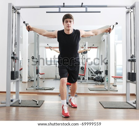 young man in fintess sport club exercise withweights and relaxing - stock photo