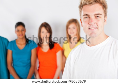 young man in front of group of people - stock photo