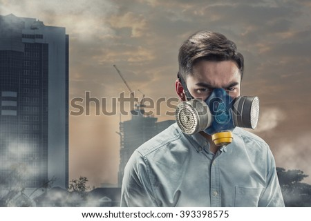 Young man in gas-mask - stock photo