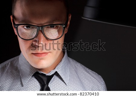young man in glasses with money reflection