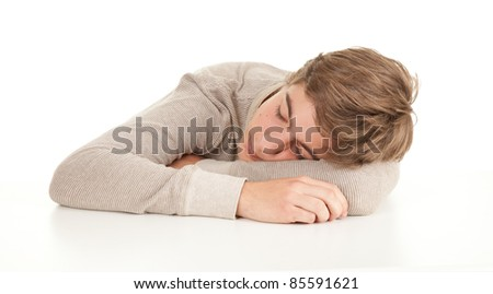 young man in grey shirt leaning on table, white background, series - stock photo