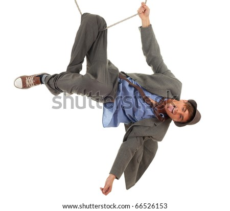 young man in grey suit in acrobatic trick on rope