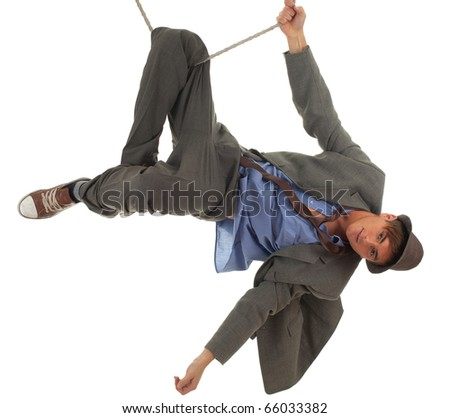 young man in grey suit in acrobatic tricks on rope