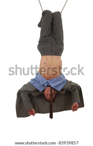 young man in grey suit in acrobatic tricks on rope - stock photo