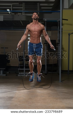 Young Man In Gym Is Jumping Rope - stock photo