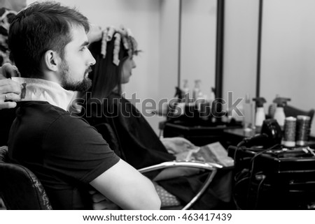 Young man in hair dressing salon. Male hair style