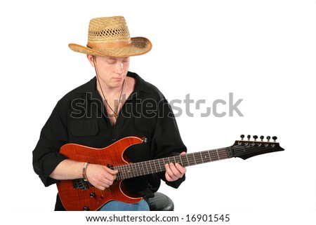 Young man in hat play on guitar