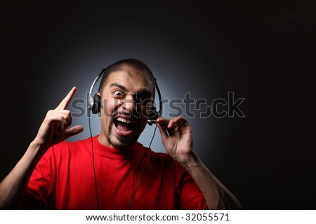 Young man in headphones screaming