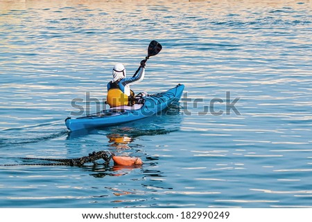 young man  in his kayak journey