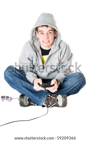 Young man in hood with a joystick for game console - stock photo