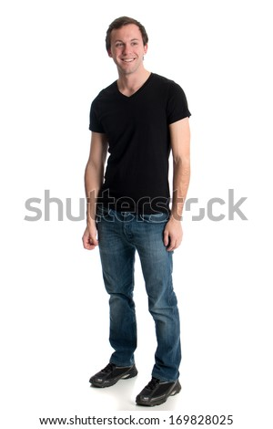 Young man in jeans and a black tee shirt. Studio shot over white. - stock photo