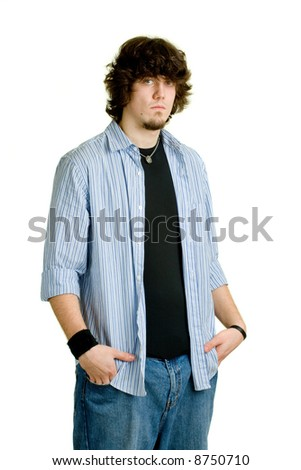 Young man in jeans and an unbuttoned dress shirt. - stock photo