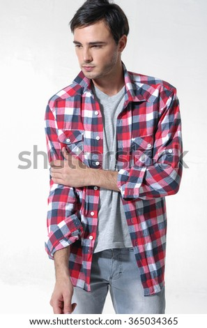 Young man in jeans isolated on a white background - stock photo