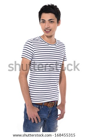 Young man in jeans standing on white background