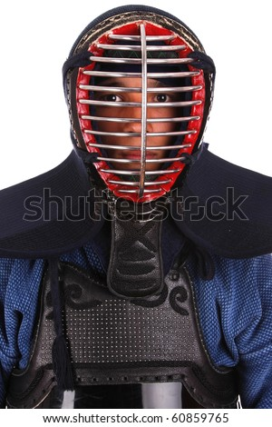 Young man in kendo (Japanese fencing) uniform. - stock photo