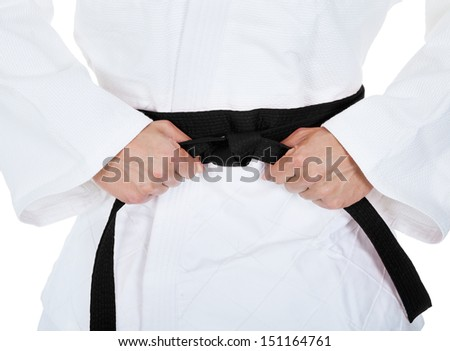 Young Man In Kimono Practicing Karate Over White Background - stock photo
