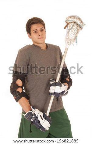 young man in lacrosse uniform holding stick - stock photo