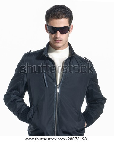 young man in lather jacket with sunglasses - stock photo
