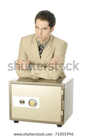 Young man in light suit, the arms folded on a safe, isolated on a white background - stock photo