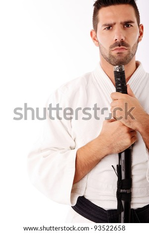 young man in martial art karate like kimono with sword - stock photo