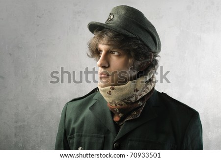 Young man in military clothes - stock photo