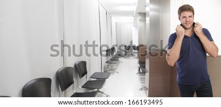 young man in office or waiting room