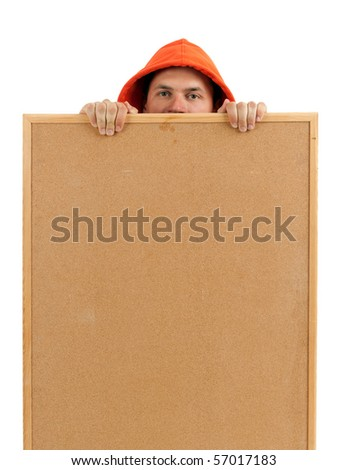 young man in orange sweatshirt and hood keeping cork board - stock photo