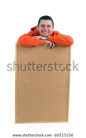 young man in orange sweatshirt keeping cork board
