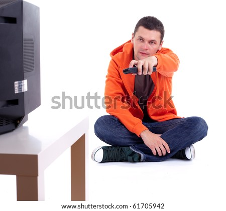 young man in orange sweatshirt watching television