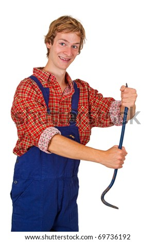 Young man in overalls holding a crowbar - isolated - stock photo