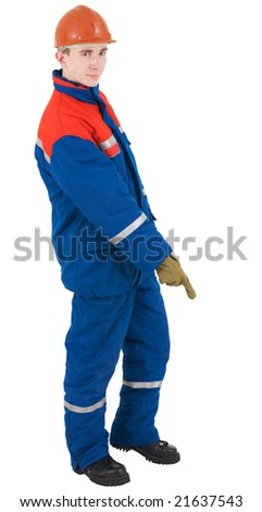 Young man in overalls of the adjuster, helmet and glove