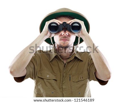 Young man in pith helmet looking through binoculars, isolated on white - stock photo