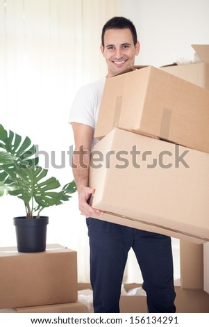 young man in process of moving house - stock photo