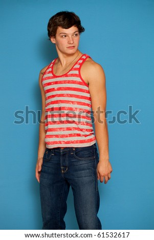 Young man in red and white striped shirt and jeans.