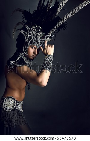 Young man in ritual suit of pagan priest. Photo. - stock photo