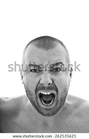 Young man in screaming pose on white background - stock photo